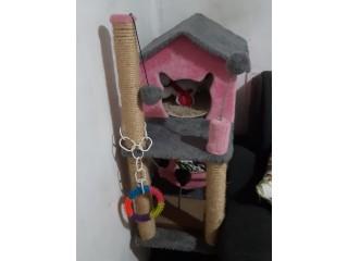 Casinha de gato de cor rosa